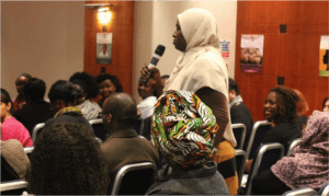 A member from the audience asking a question
